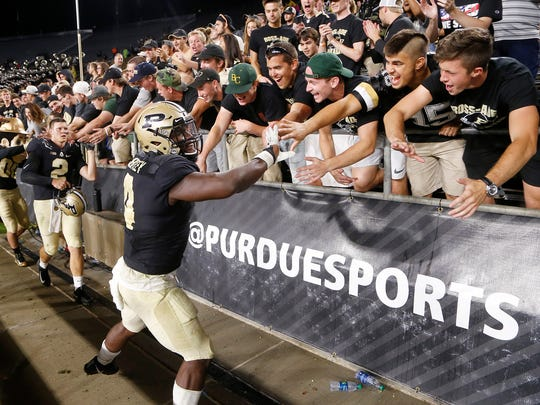Ja'Whaun Bentley shakes hands with fans after Purdue defeated Minnesota 31-17 Saturday, October 7, 2017, at Ross-Ade Stadium. Bentley intercepted a Minnesota pass and ran for a touchdown with only seconds remaining to seal the victory.