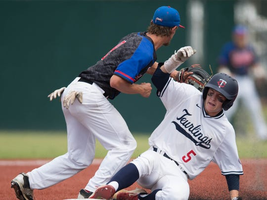 Teurlings Catholic's Hayden Cantrelle (5) slides into second base after hitting the double in the LHSAA state baseball class 4A championship game between Teurlings Catholic and West Quachita in Sulfur.
