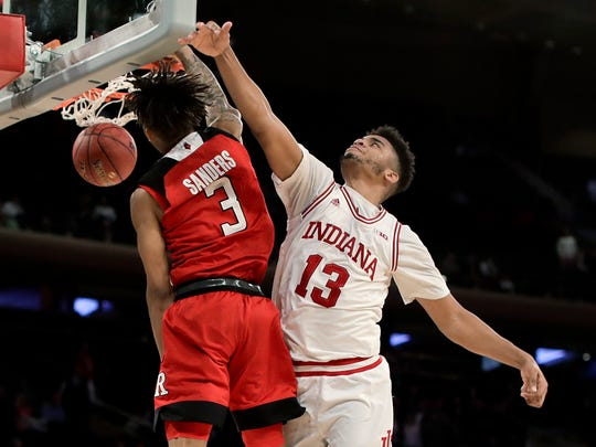 Rutgers guard Corey Sanders (3) dunks against Indiana forward Juwan Morgan (13) during the second half of an NCAA college basketball game in the Big Ten men's tournament Thursday, March 1, 2018, in New York. Rutgers won 76-69. (AP Photo/Julie Jacobson)