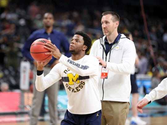 Michigan guard Zavier Simpson warms up before the national championship game against Villanova on Monday, April 2, 2018, at the Alamodome in San Antonio.