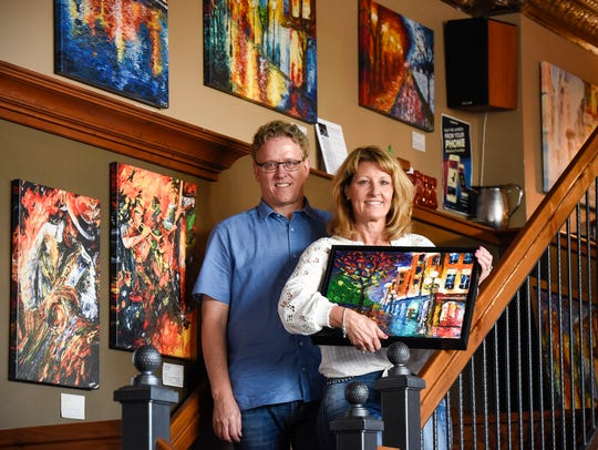Scott & Reyne Roeder show some of their son's artwork Friday, May 25, on display at Old Capital Tavern in Sauk Rapids. Their son Jackson, 25, was dealing with mental health issues and in February died by suicide.