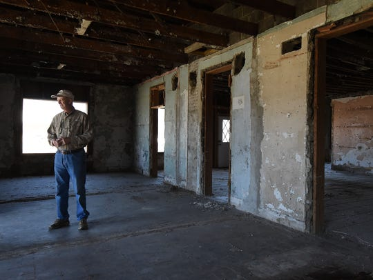 Jack Gilliland stands inside the old Rollins Hospital