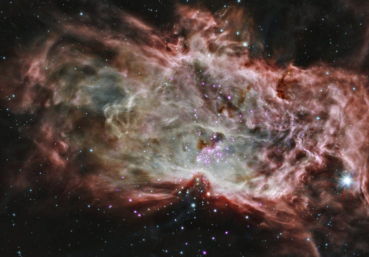 A composite image of the star cluster NGC 2024, which is found in the center of the so-called Flame Nebula about 1,400 light years from Earth.