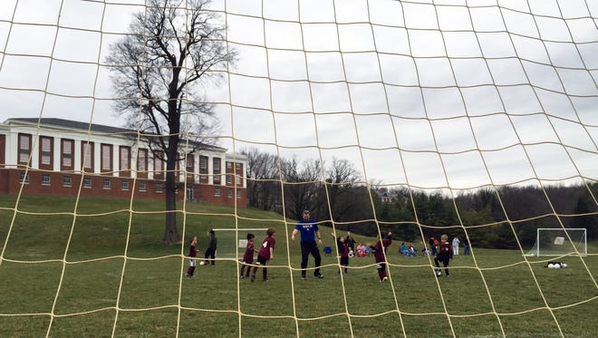 Stephen Strosnider and his U8 players warm up before games Saturday at VSDB as part of SOCA's opening weekend.