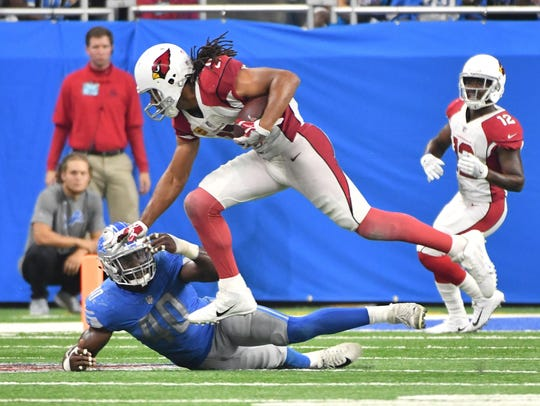 Cardinals wide receiver Larry Fitzgerald makes a running