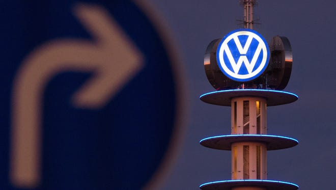 Volkswagen appeared in federal court in Detroit on Friday, March 10, 2017 to plead guilty to cheating on emissions tests. The scandal has engulfed the Wolfsburg, Germany based company. Here, a street sign can be seen in front of the illuminated logo of German car maker Volkswagen  on Dec. 10, 2015.