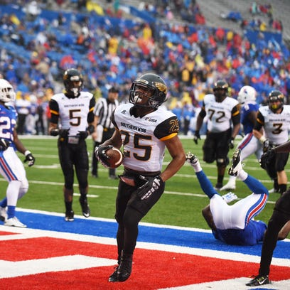 Southern Miss running back Ito Smith scores a touchdown