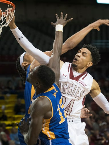 Aggies guard Matt Taylor overpowers two CSU Bakersfield