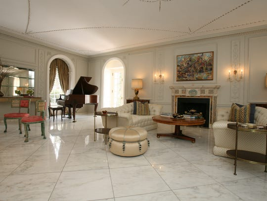 The living room in this 1914 mansion for auction, on