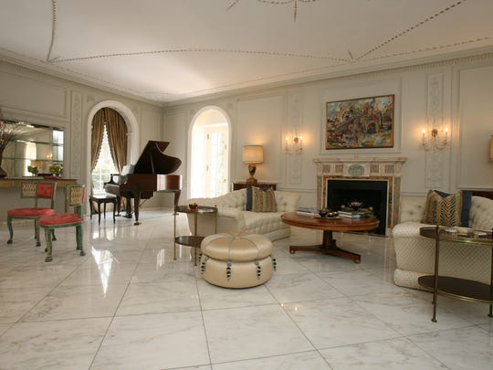 The living room in this 1914 mansion for auction, on 3.75 acres on Cooper Road in Scarsdale.