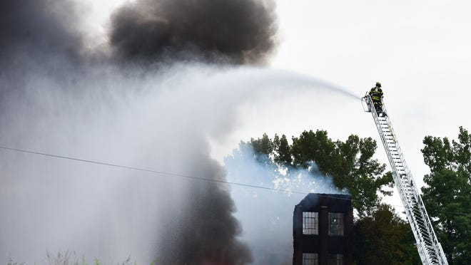 Several fire departments battle a large fire that broke out at the former CharlesTown Mall in the early morning of Thursday, Aug. 27, 2020, at border of Utica and Frankfort.