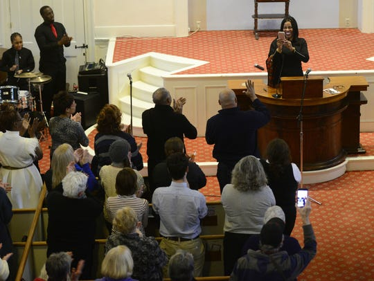 Ilyasah al Shabazz uses her cell phone to snap a picture