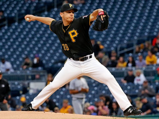 Pittsburgh Pirates' Chad Kuhl delivers in the first inning of a baseball game against the Milwaukee Brewers in Pittsburgh, Friday, May 5, 2017. (AP Photo/Gene J. Puskar)