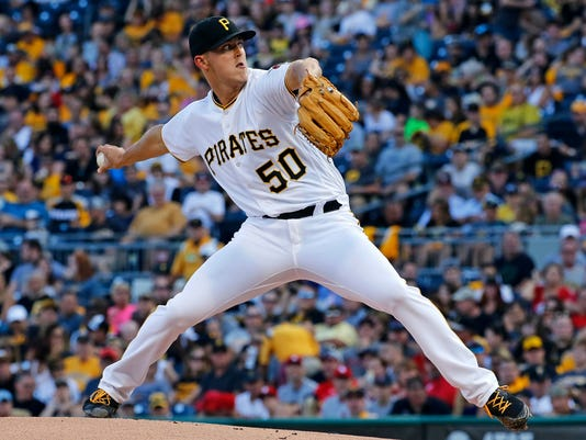 Pittsburgh Pirates starting pitcher Jameson Taillon delivers in the first inning of a baseball game against the St. Louis Cardinals in Pittsburgh, Saturday, July 15, 2017. (AP Photo/Gene J. Puskar)