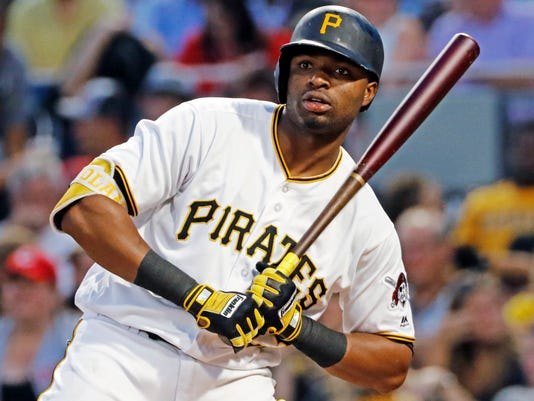 Pittsburgh Pirates' Gregory Polanco gets a sign during a fifth inning at-bat against Cincinnati Reds starting pitcher Robert Stephenson in a baseball game in Pittsburgh, Wednesday, Aug. 2, 2017. Polanco drew a walk. It was Polanco's first game back off the disabled list. (AP Photo/Gene J. Puskar)