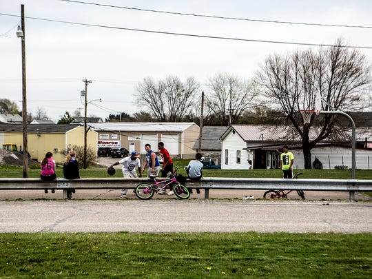 Children play in Woodsfield, the county seat of Monroe County, Ohio. This historically Democratic area voted overwhelming for President Donald Trump in the 2016 election.