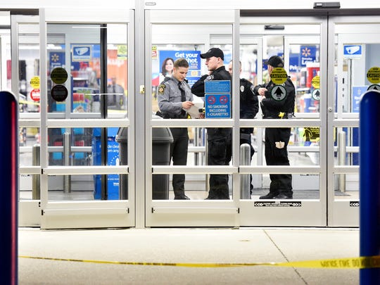 Law enforcement officers gather in one entrance at the scene of a shooting at Wal-Mart in Shrewsbury.