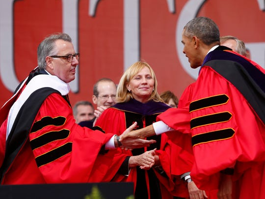 President Barack Obama, right, shakes hands with Greg Brown, left, of the Rutgers Board of Governors, after Obama delivered the commencement address during Rutgers University's 250th Anniversary Commencement in 2016.