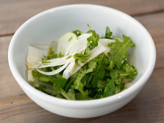 Shaved apple, fennel and arugula salad with a lemon