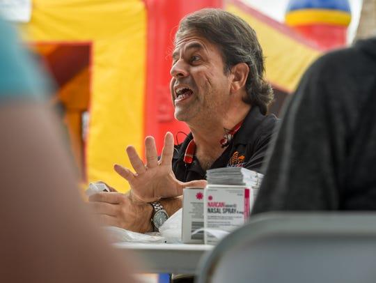 Former firefighter Luis Garcia gave away nasal Narcan,