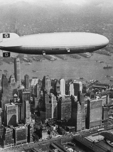 NEW YORK, UNITED STATES:  Image dated of the 30's showing German giant airship Hindenburg flying over Manhattan island in New York.