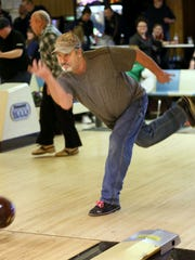 Paul Quesnell of West Allis puts some muscle behind the bowling ball to speed it on its way.