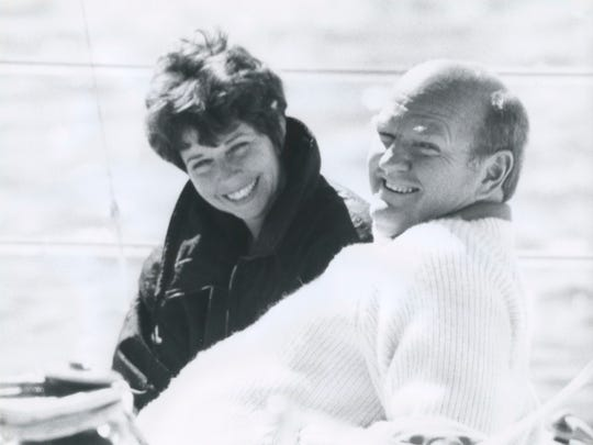 In this undated photo provided by the Warren Miller Co., Warren Miller, right, is seen with his wife, Laurie Miller while on a boat. Miller, the prolific outdoor filmmaker who for decades made homages to the skiing life that he narrated with his own humorous style, died Wednesday, Jan. 24, 2018, at his home on Orcas Island, Wash., his family said. He was 93. A World War II veteran, ski racer, surfer and sailor, Miller produced more than 500 films on a variety of outdoor activities. However it was his ski films for which he was most known. (Warren Miller Co. via AP)