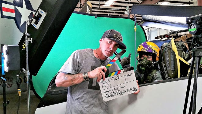 """With Susannah Jane in the cockpit, director Rob Hawk prepares to shoot a """"Wing Girl"""" scene at the Air Victory Museum in Lumberton."""