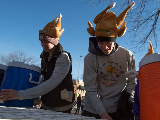 Natalie Anderson and Kyle Sherman wear turkey hats