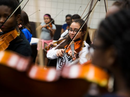 Aliyah Lancon, student at Naples High School, looks at her fellow students while playing during a rehearsal with Barrage 8, a professional string group, at Pine Ridge Middle School on Monday, February 13, 2017 in North Naples. The group will perform with students on Friday as a part of the master class  presented by the Naples Music Club.