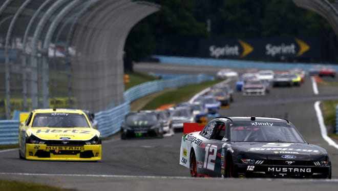 Joey Logano leads a pack of cars during his win in the Zippo 200 at The Glen on Saturday.