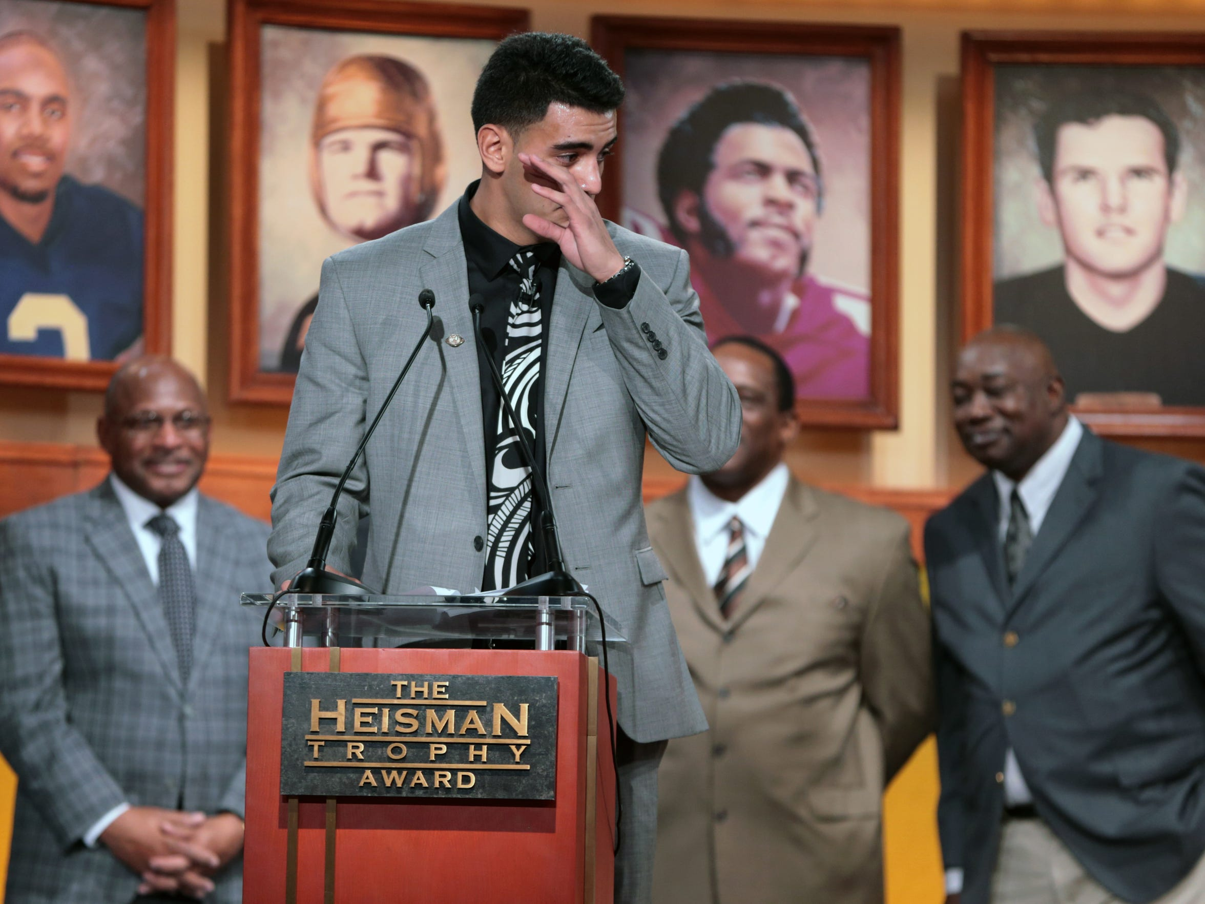Oregon quarterback Marcus Mariota tears up while speaking after being named the Heisman Trophy winner on December 13, 2013 in New York.