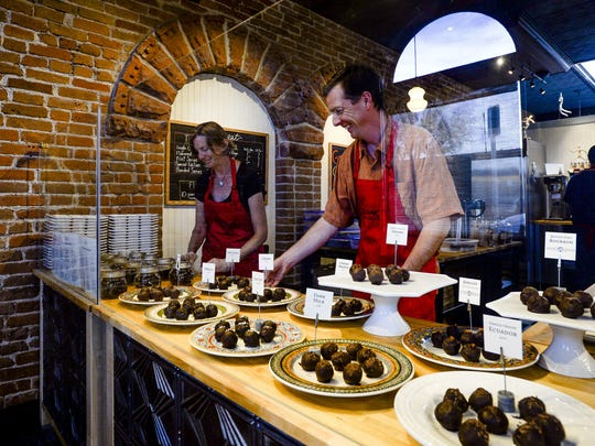 Alix and Toby Gadd set up their truffle display at  Nuance Chocolate in 2014.