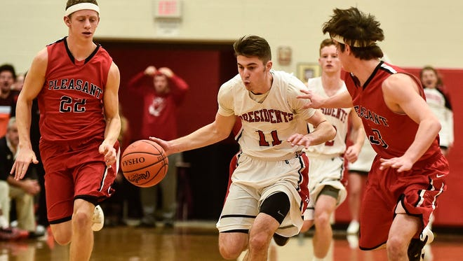 Harding's Tyler Longstreth dribbles up the court at Pleasant earlier this season. The Presidents and Spartans along with all other boys basketball teams open up sectional tournament play this week.