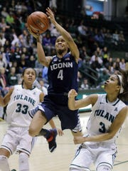 Connecticut guard Moriah Jefferson (4) goes to the basket between Tulane guard Donielle Breaux (33) and Tulane guard/forward Veja Hamilton (3).