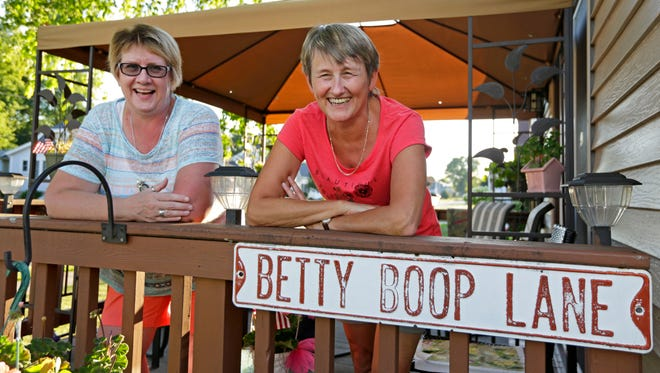 Diane Bartman (left) and Angie Unterholzner, a German exchange student in 1979, continue their friendship as their families spend time with each other Wednesday during a cookout at Diane's mother's house in Appleton.
