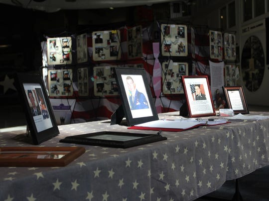 Photos on display as part of the 'Remembering Our Fallen' exhibit.