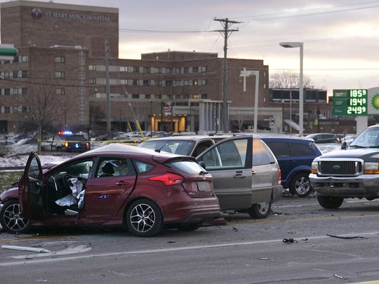 The Wayne County Medical Examiner's office said three people were killed in this multi-car accident at Five Mile and Levan.