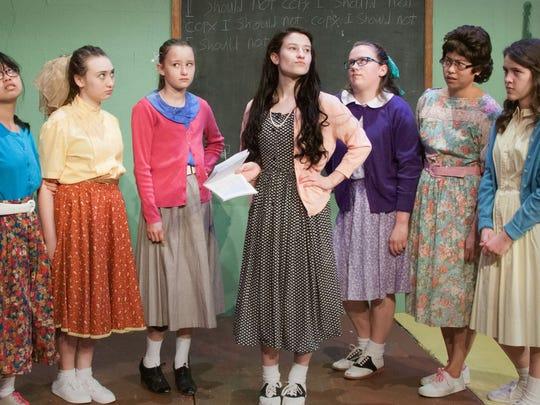 Homeschoolers perform a play set in a public school