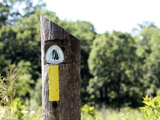 An Ice Age Trail sign marks the trail near Lapham Peak.
