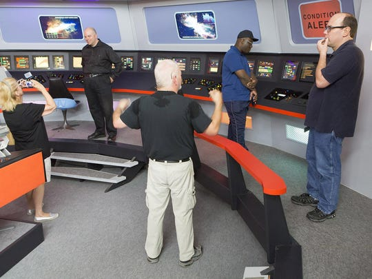 "Volunteer Kent Schmidt gives a tour of the USS Enterprise to a group of ""Star Trek"" fans in Ticonderoga, New York. See a video of the Starship attraction at www.burlingtonfreepress.com"