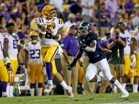 LSU tight end Thaddeus Moss (81) catches a deep pass against Georgia Southern cornerback Monquavion Brinson (4) in the second quarter of an NCAA college football game in Baton Rouge, La., Saturday, Aug. 31, 2019. (AP Photo/Michael Democker)
