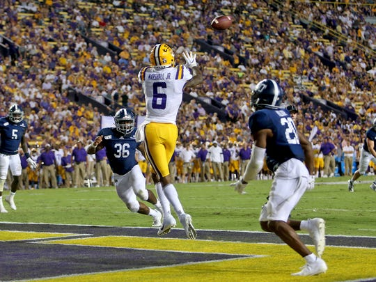 LSU wide receiver Terrace Marshall Jr. (6) catches a 3-yard touchdown against Georgia Southern in the second quarter of an NCAA college football game in Baton Rouge, La., Saturday, Aug. 31, 2019. (AP Photo/Michael Democker)