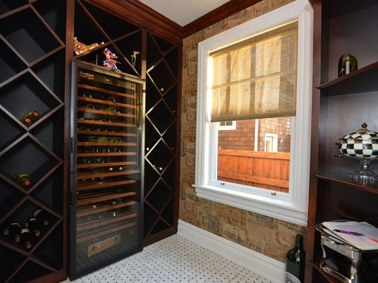 There is a wine rack and custom wine room inside the mansion.