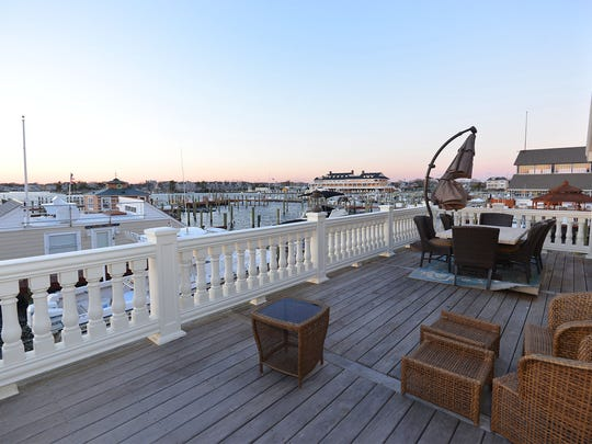 The deck has expansive views of the water.