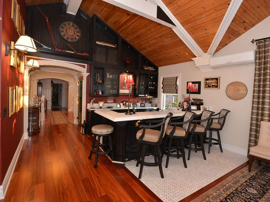 The gourmet chef's kitchen has a Carrera marble center island and matching countertops.