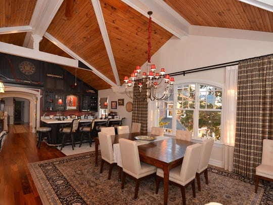 This kitchen includes a wet bar and dining area all with vaulted ceilings.