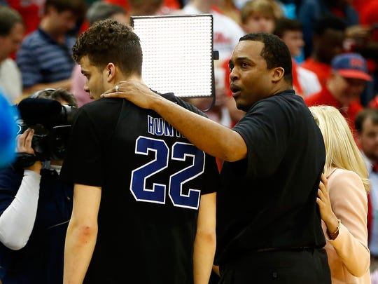 Head coach Ron Hunter of the Georgia State Panthers puts his arm around son and player R.J. Hunter (22) after the Panthers 57-56 win against the Baylor Bears during the second round of the 2015 NCAA Men's Basketball Tournament at Jacksonville Veterans Memorial Arena on March 19, 2015 in Jacksonville, Florida.
