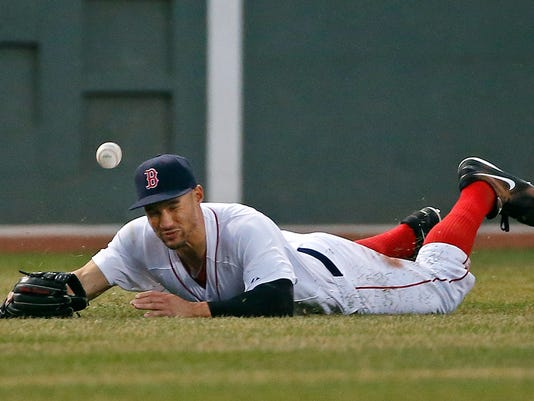 Boston Red Sox center fielder Grady Sizemore dives but cannot come up with an RBI double by Texas Rangers' Donnie Murphy in the third inning of a baseball game at Fenway Park in Boston, Tuesday, April 8, 2014. (AP Photo/Elise Amendola)