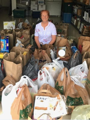 Stamp Defiance Chapter (National Society Daughters of the American Revolution) member Paula DeSilva and her (husband of DAR), Hema, organized a food drive in Brunswick Forest, Leland.
